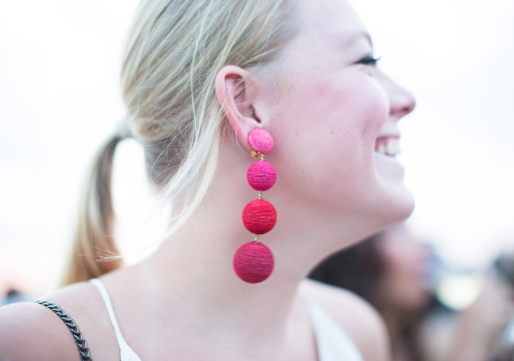 Woman with large fuchsia earring