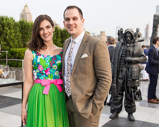 Two people pose at The Met Roof Garden Bar