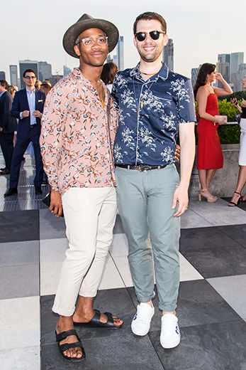 Two men pose at The Met Young Members Party