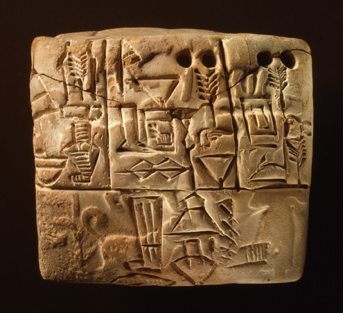Cuneiform tablet: administrative account of barley distribution with cylinder seal impression of a male figure, hunting dogs, and boars, 3100–2900 B.C. Clay; 2.17 x 2.36 x 1.63 in. (5.5 x 6 x 4.15 cm). The Metropolitan Museum of Art, New York, Purchase, Raymond and Beverly Sackler Gift, 1988 (1988.433.1)