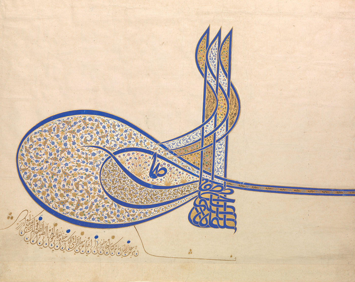 A highly ornate calligraphic Arabic signature in blue and decorated profusely with tiny painted and gilded flowers in blue and white