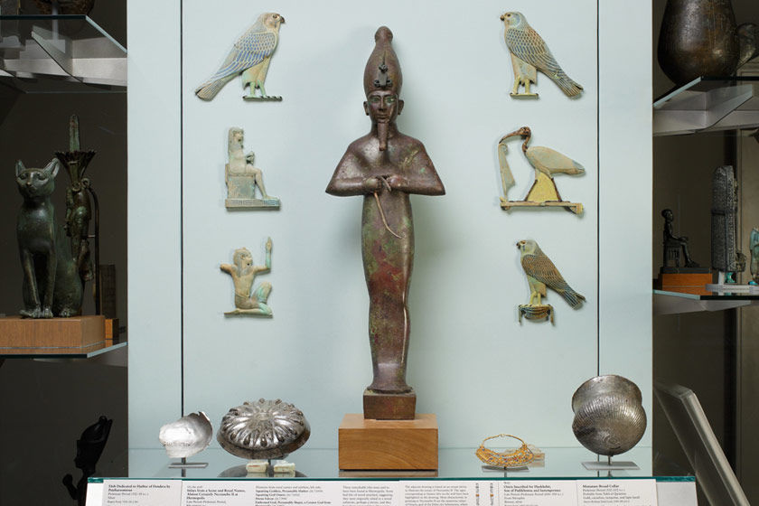 Vitrine of objects from ancient Egypt on display in a gallery