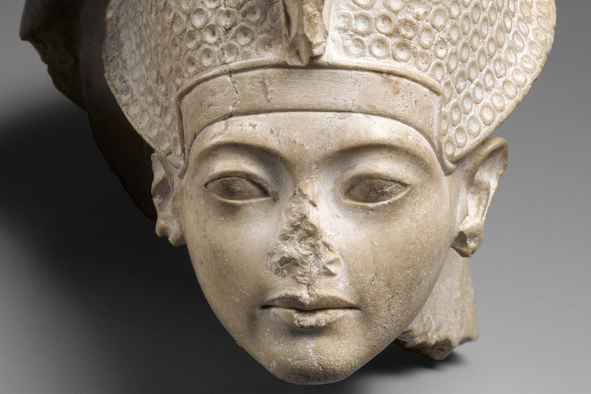 Detail view of a stone sculpture of a head from ancient Egypt
