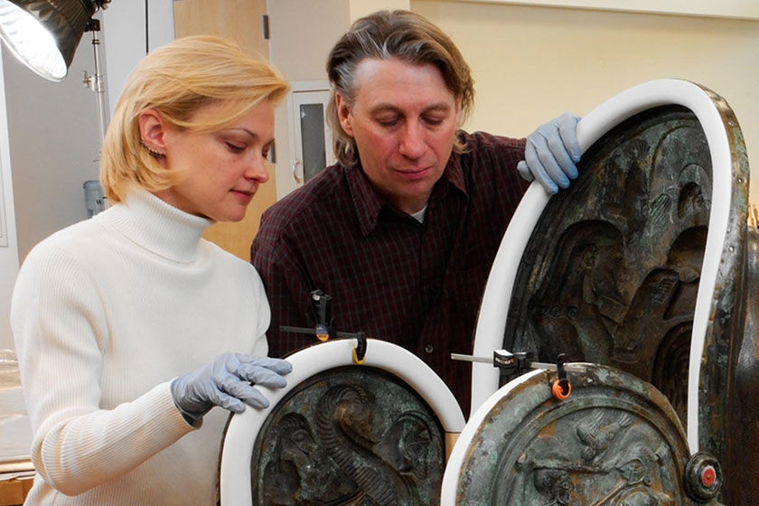 Two staff members of the Department of Objects Conservation inspect an artwork from The Met collection