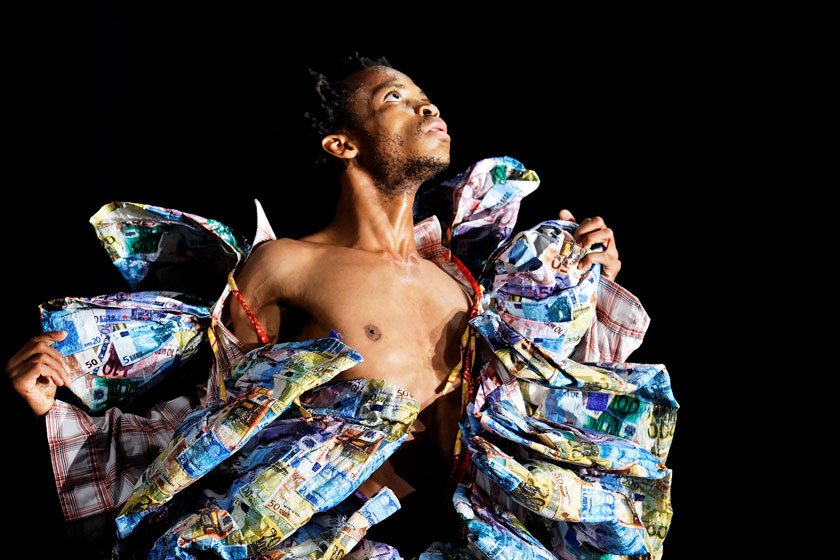 A male dancer against a black background