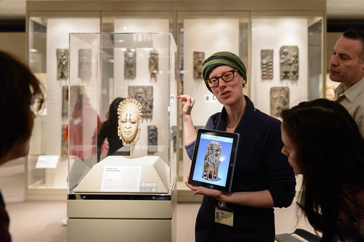 A Museum educator leads a workshop in the galleries