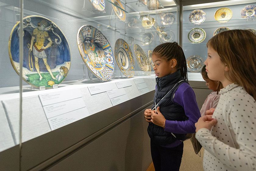 Young girls in gallery looking at Italian Renaissance pottery