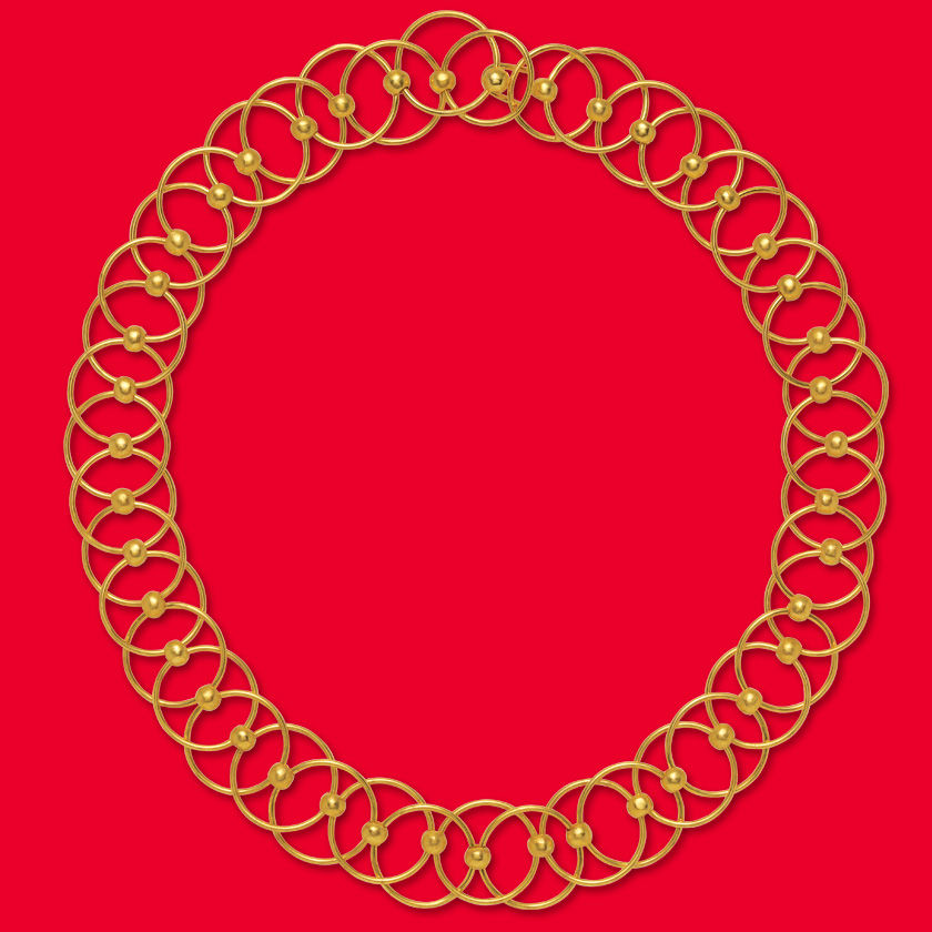 A gold necklace against a red background