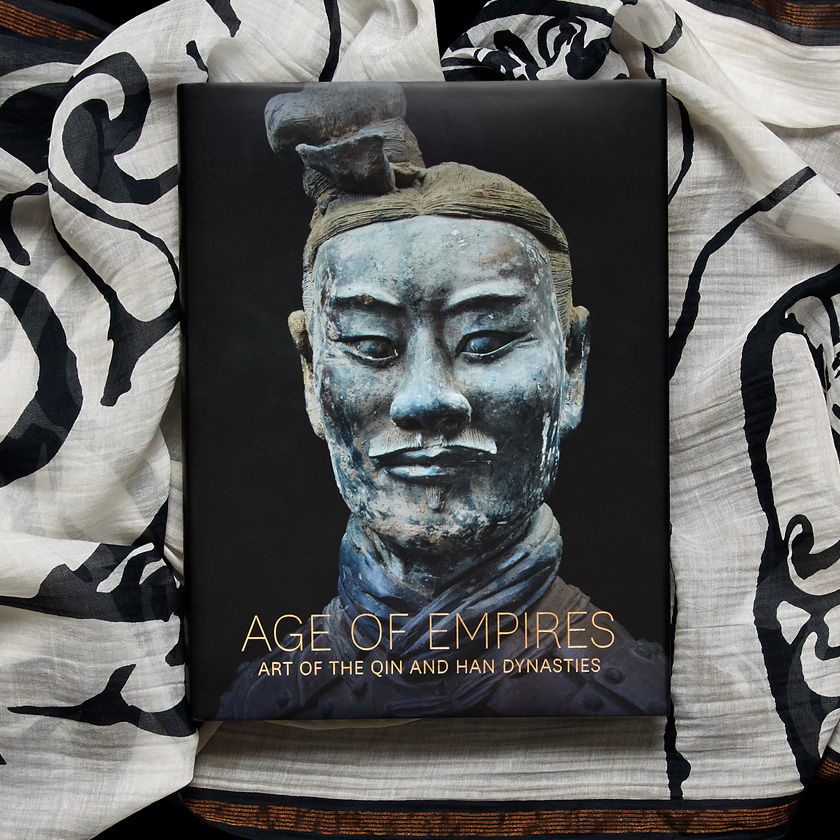 Book cover featuring the head of a terracotta warrior against a black-and-white scarf