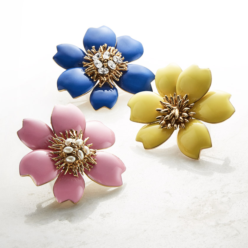 Photo of three brightly colored floral enamel pins