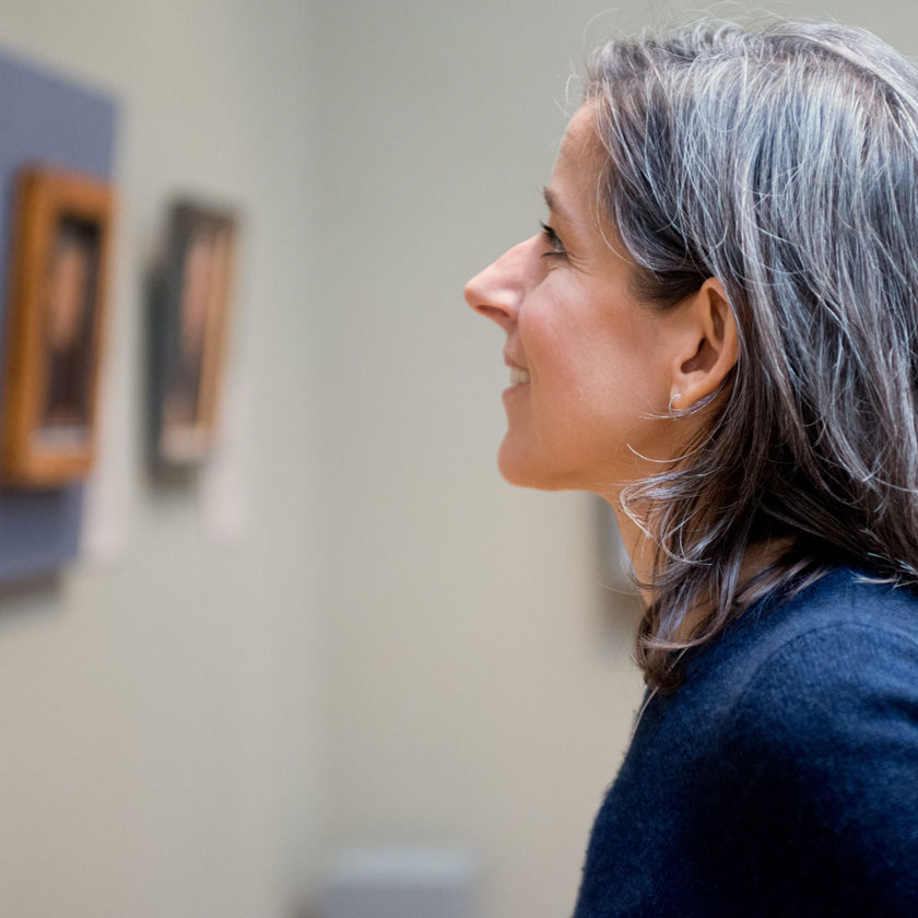 Woman looking at art in the galleries