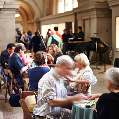 Café with tables and chairs, and live classical music
