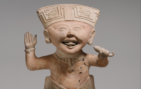 Detail view of a 7th–8th-century Remojadas ceramic in the form of a smiling boy