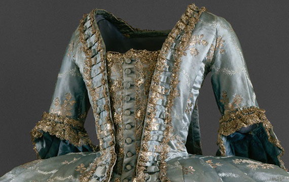 Robe à la Française, a full-length gown made from blue siilk with gold floral motifs
