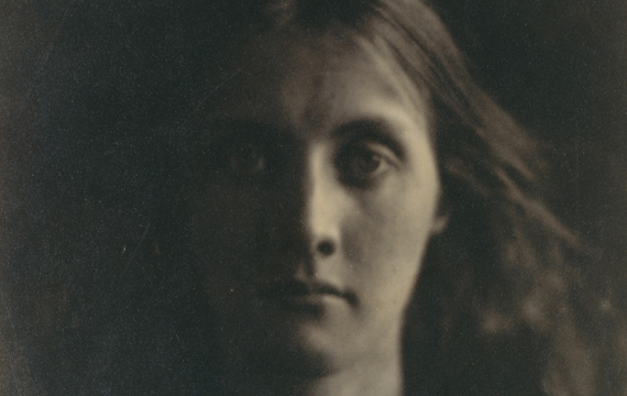 Detail view of a mid-19th-century photograph by Julia Margaret Cameron of a woman with long hair staring intently at the camera