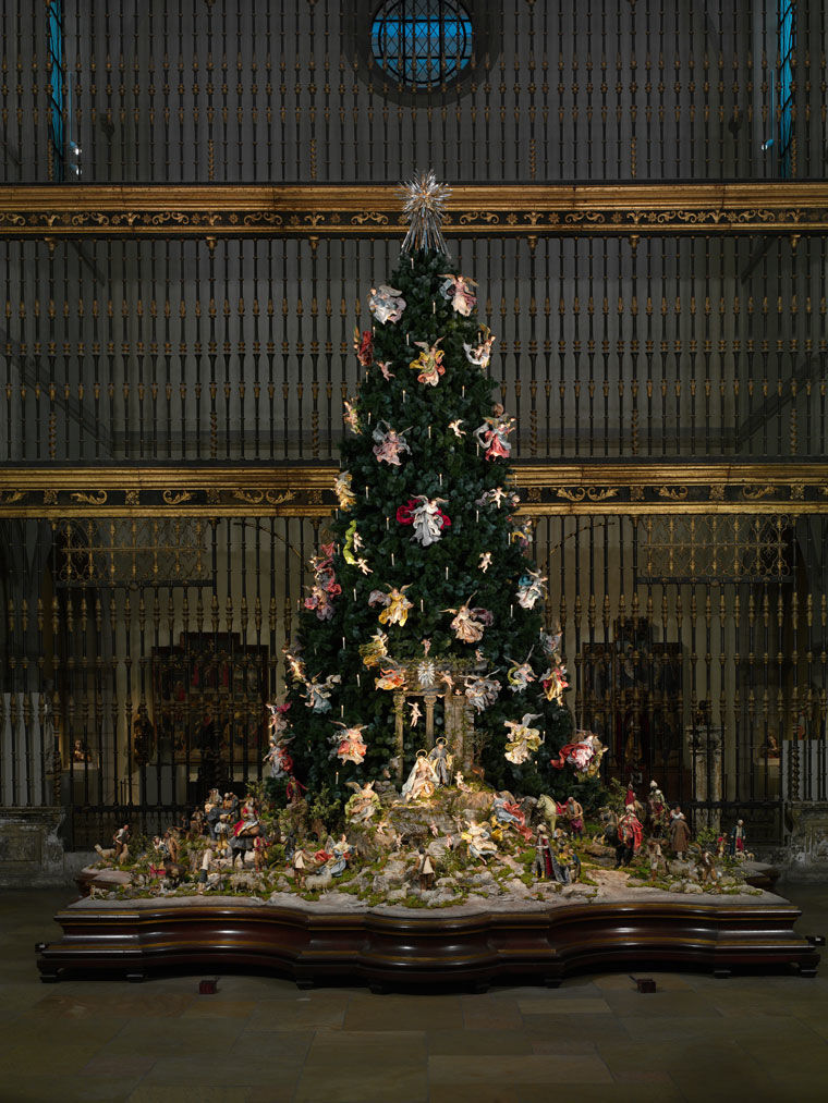 View of The Met's Christmas tree and Neapolitan creche installed in a medieval sculpture gallery