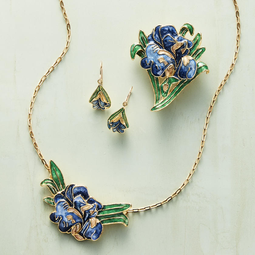 View of colored enamel jewelry in the shapes of various flowers