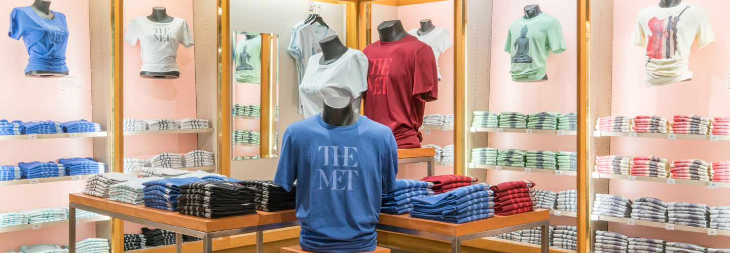 View of The Met Store showing a display of Met-branded t-shirts