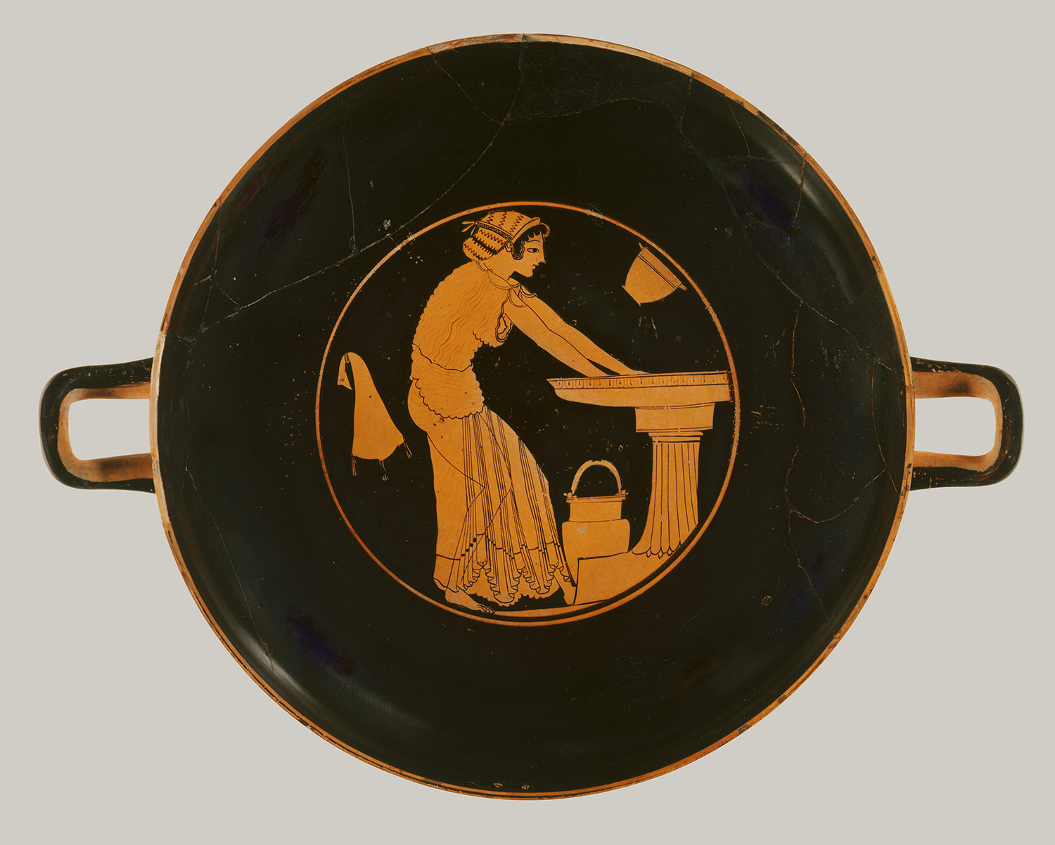 women in the classical world classical studies libguides at young w bending over water basin kylix ca 500 b c red figure