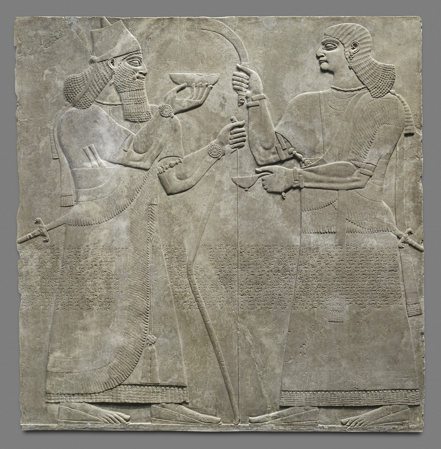 Relief king and eunuch attendant excavated at nimrud