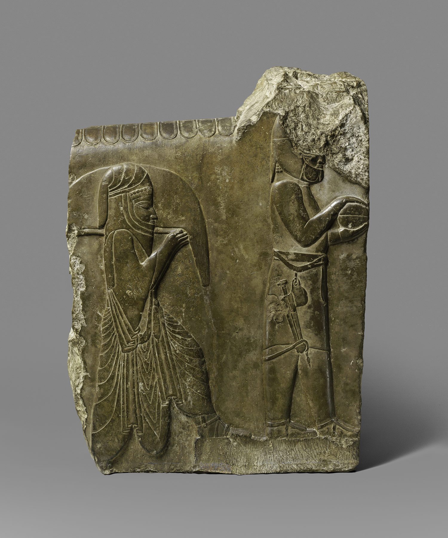 two servants bearing food and drink, Achaemenid period