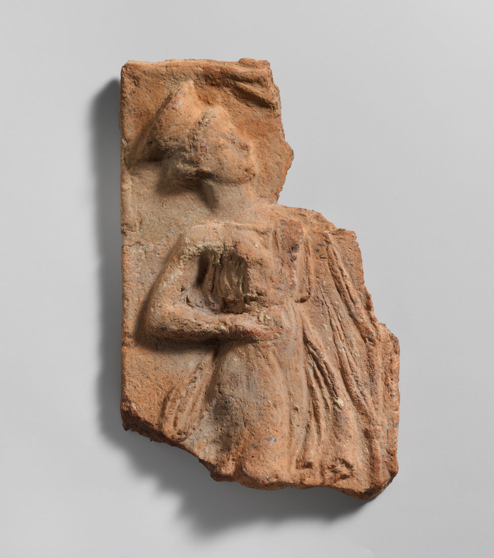 <B>Fragmentary terracotta pinax (plaque) with a dancing girl</B>, 5th century B.C., Cretan (53.5.39)