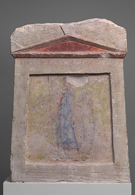 Painted limestone funerary slab with a soldier standing at ease