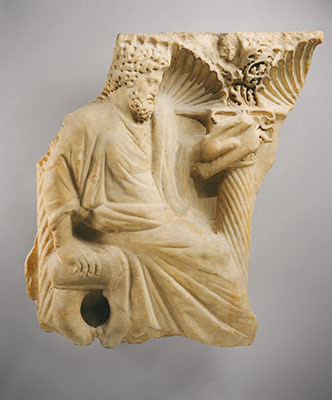 Fragment of a sarcophagus with a seated figure