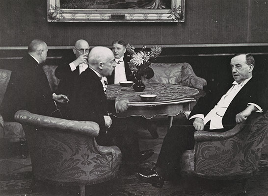 [Five Gentlemen Conversing around a Table]