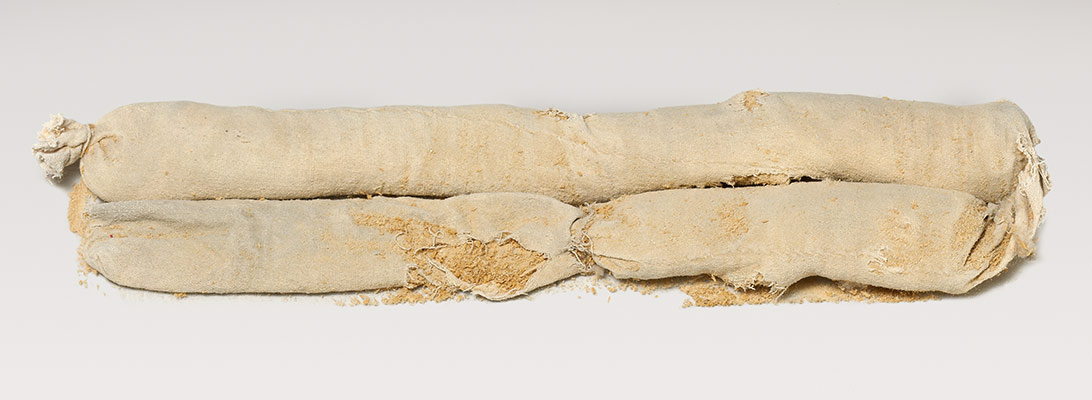 Cylindrical bag of sawdust from Tutankhamuns embalming cache