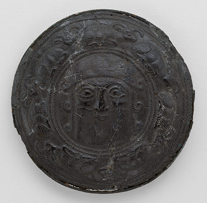Roundel with the head of a hero surrounded by caprids
