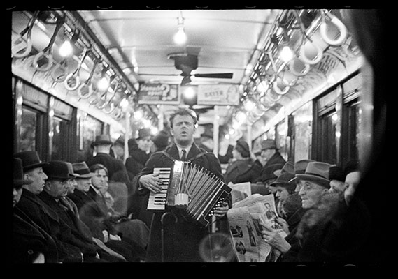 [View Down Subway Car with Accordionist Performing in Aisle, New York City]