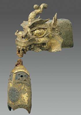 Rafter finial in the shape of a dragons head and wind chime