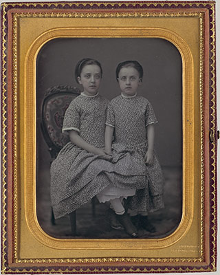 [Two Girls in Identical Dresses]