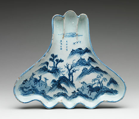 Dish in the shape of Mount Fuji with a design of horses and deer