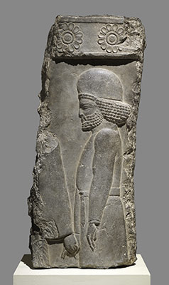 Relief: figure in a procession