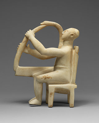 Marble seated harp player