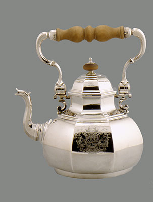 Teakettle, lamp, and table