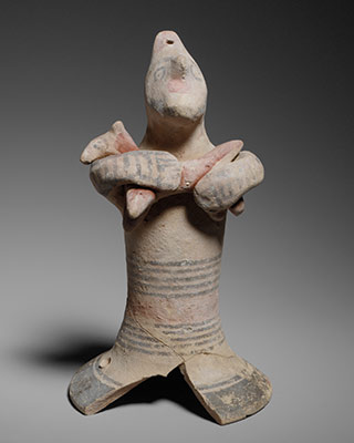 Terracotta statuette of a man holding a quadruped