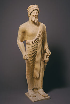 Limestone statue of a bearded man with votive offerings