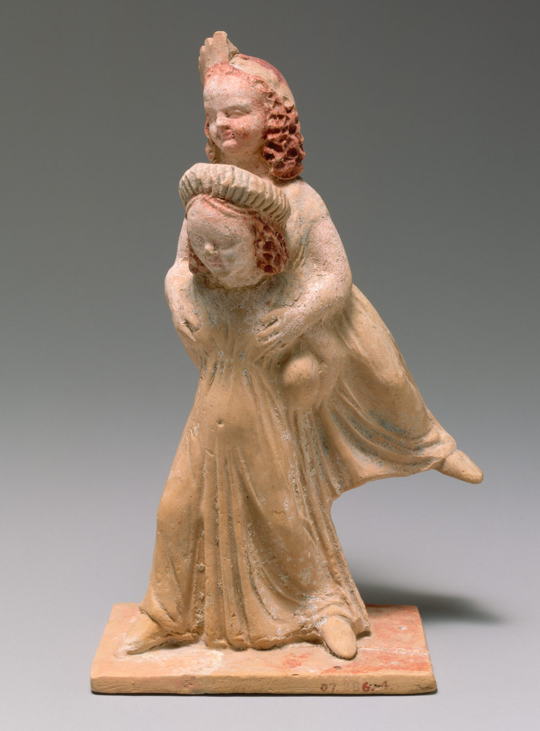 Terracotta group of two girls playing a game known as ephedrismos