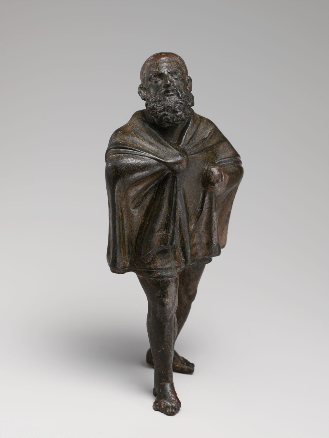Statuette of a draped man
