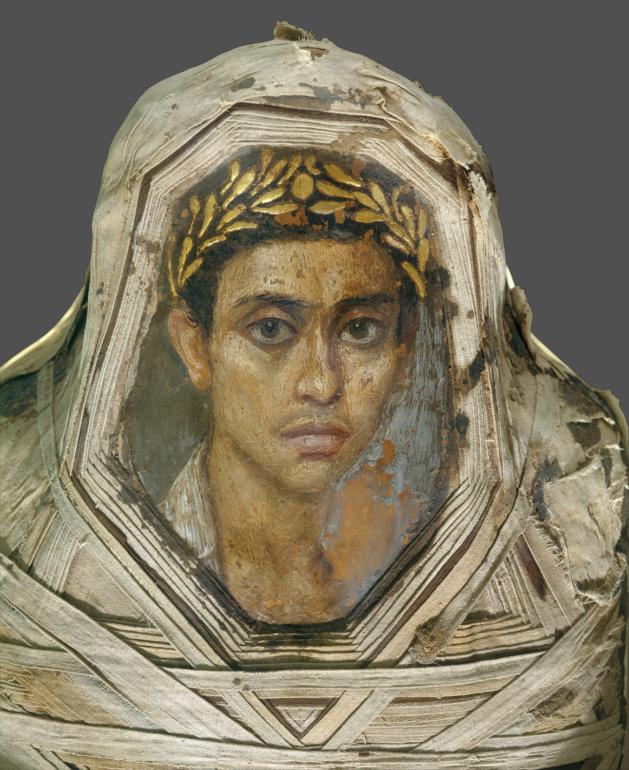 Mummy with an inserted panel portrait of a youth   Work of ...