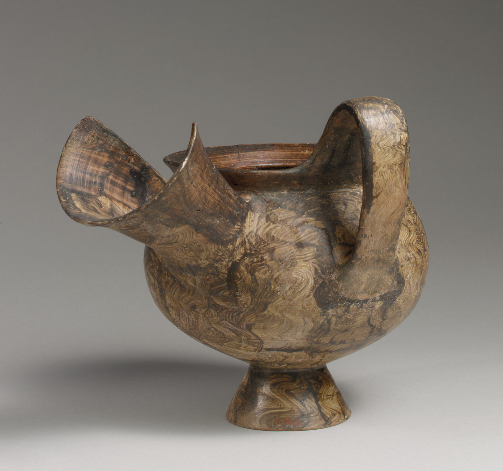 Jug with an oversized spout
