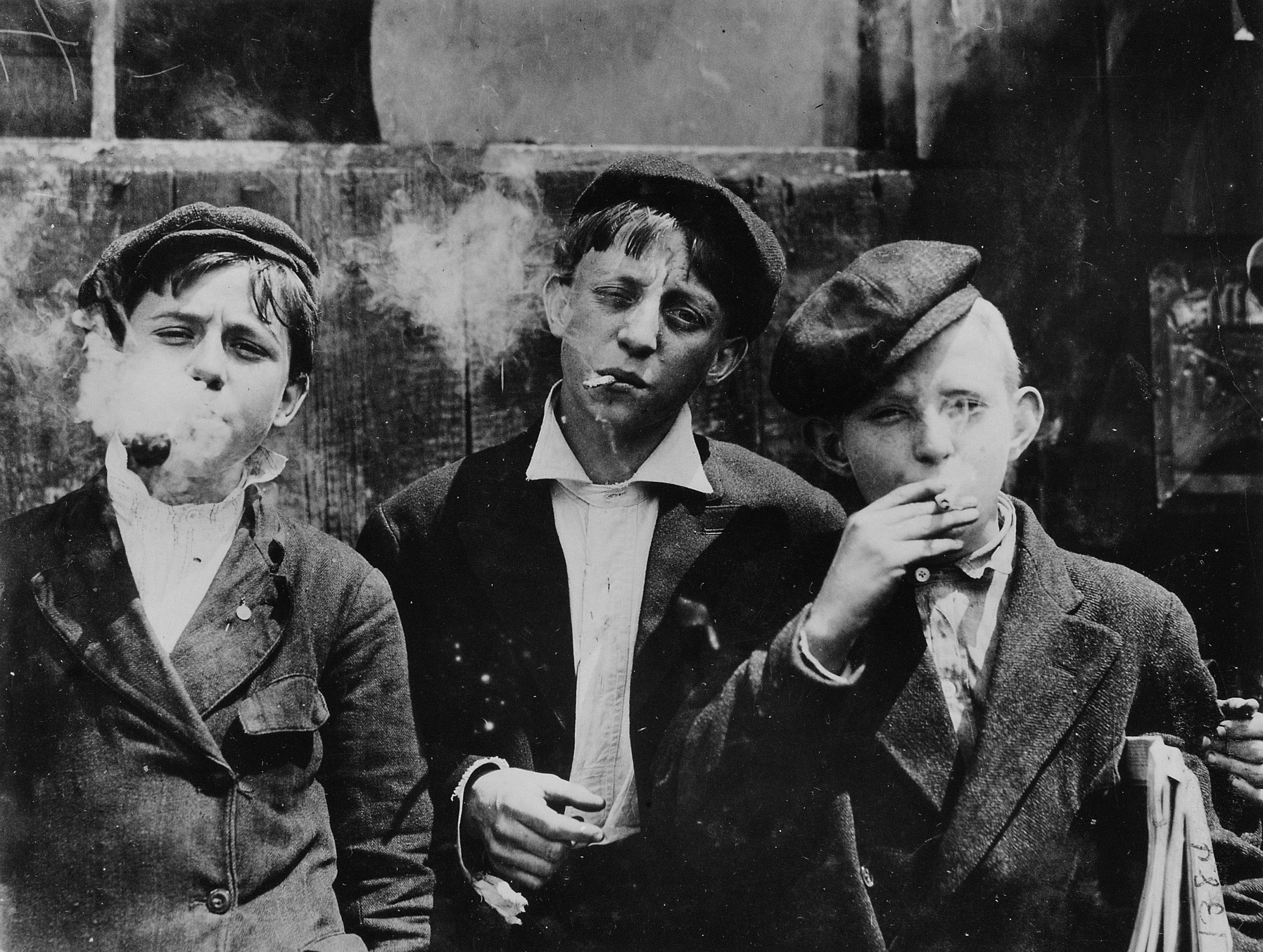 11:00 A.M. Monday, May 9th, 1910. Newsies at Skeeters Branch, Jefferson near Franklin. They were all smoking. Location: St. Louis, Missouri.