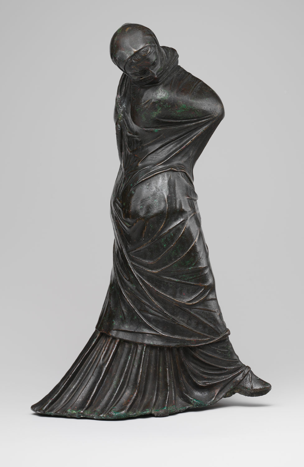 Bronze statuette of a veiled and masked dancer | Greek