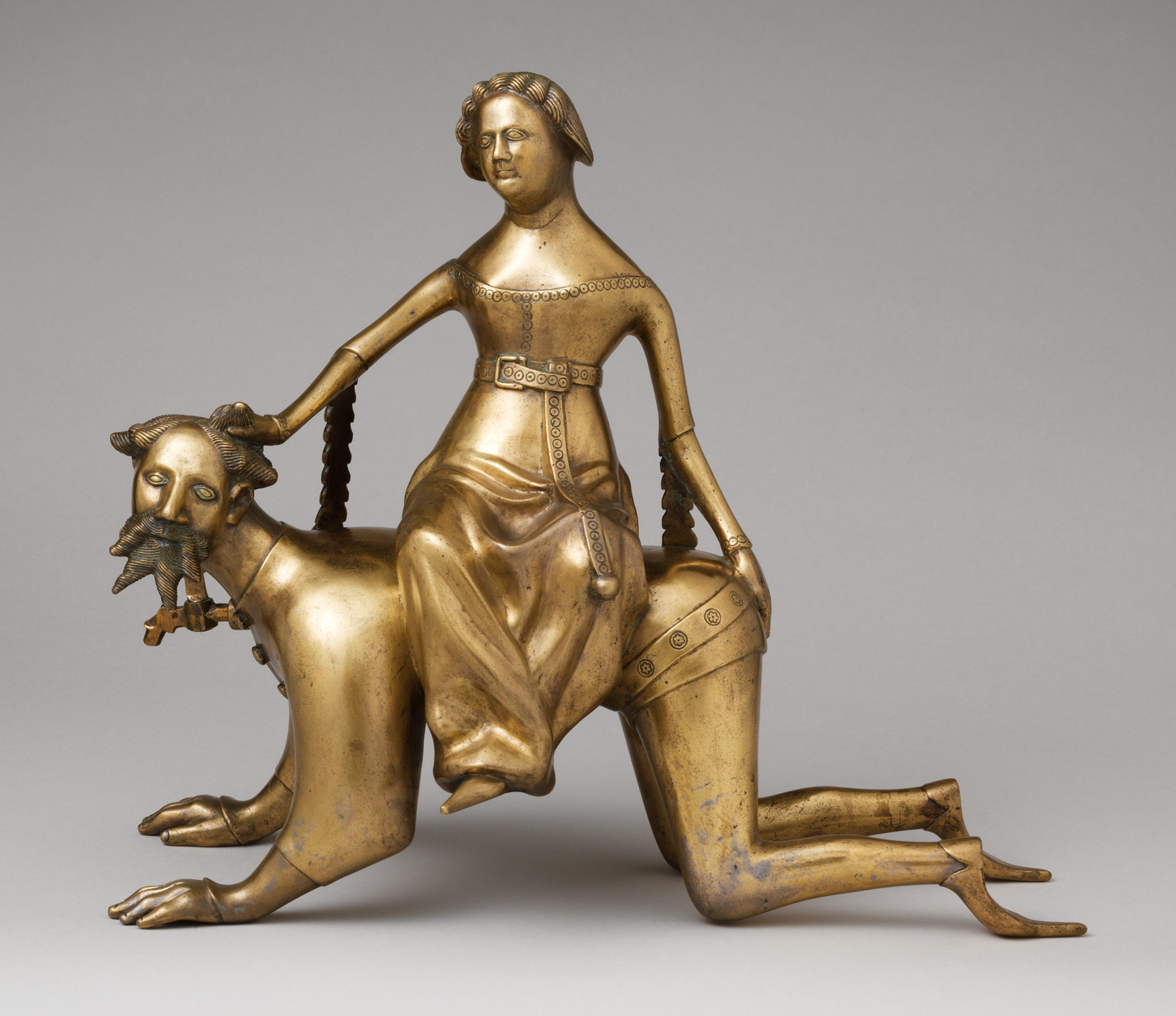 Bronze water holder in shape of a man on his knees and a woman sitting on his back.