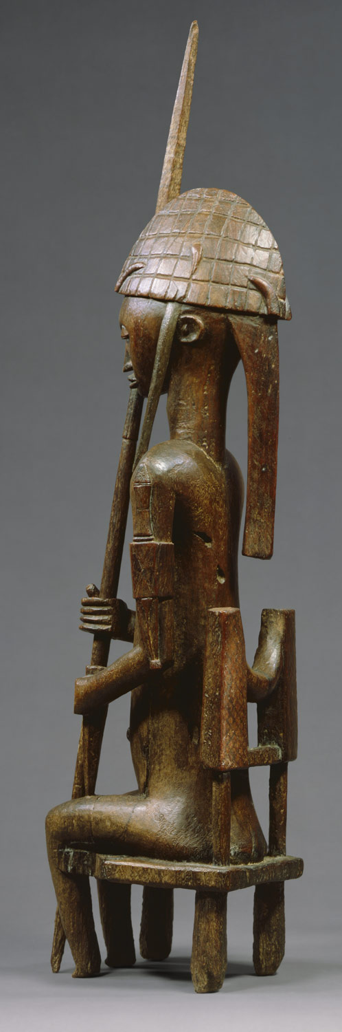 Seated Male Figure with Lance