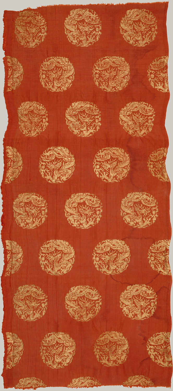Textile with coiled dragons