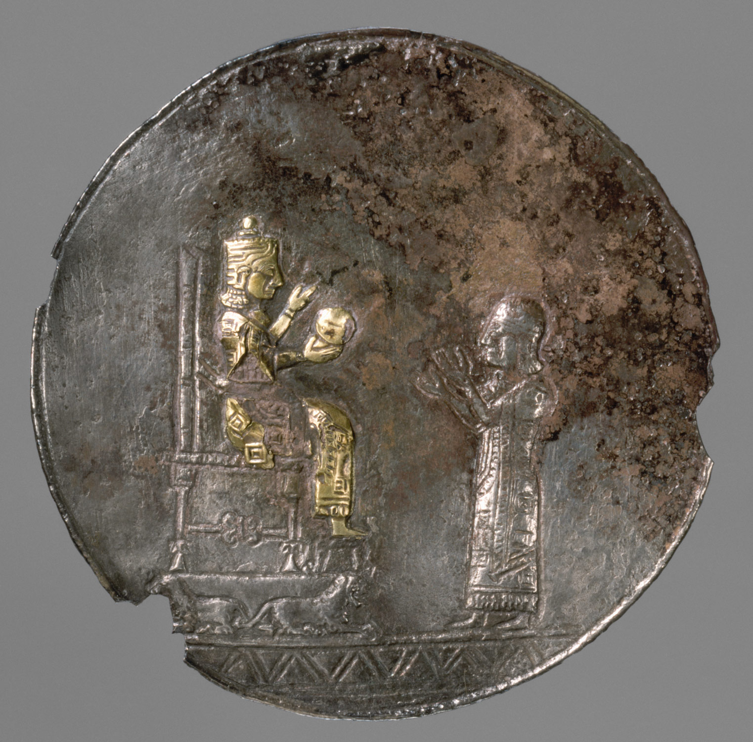 Medallion with a seated deity and a male worshipper